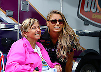Jun 5, 2015; Englishtown, NJ, USA; NHRA top fuel driver Leah Pritchett poses with a fan for a picture during qualifying for the Summernationals at Old Bridge Township Raceway Park. Mandatory Credit: Mark J. Rebilas-