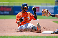 Jonathan Villar (45) of the Fresno Grizzlies slides into third base during the game against the Salt Lake Bees in Pacific Coast League action at Smith's Ballpark on June 14, 2015 in Salt Lake City, Utah.  (Stephen Smith/Four Seam Images)