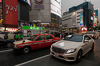 Taxis and cars pass by Yuriko Koike  as she is electioneering for her Party of Hope (Kibo no To) at Shibuya crossing, Shibuya, Tokyo, Japan. Friday October 13th 2017 Koike became the Governor of Tokyo after splitting from the ruling Liberal Democratic Party (LDP)  and running against their candidate. She formed her own party after Prime Minister Shinzo Abe called a snap election. Though not running for office herself this election she remains a popular figure and campaigns for her candidates. and is predicted to weaken Abe's majority. in the Diet.