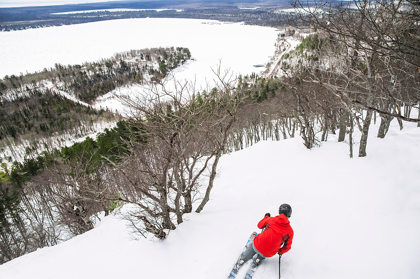 A skier explores the gladed tree skiing at Mount Bohemia on Michigan's Keweenaw Peninsula.