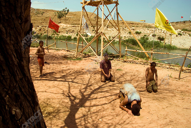 Hezbollah camp counselors pray at Camp Duty. Litani River, South Lebanon. August 2005
