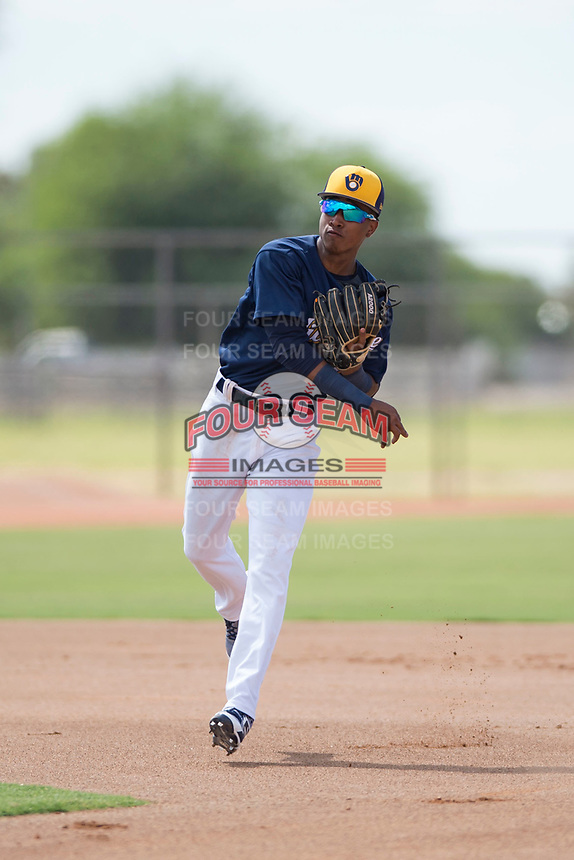 Milwaukee Brewers second baseman Yeison Coca (96) throws to first base on a double play attempt during an Instructional League game against the Los Angeles Dodgers at Maryvale Baseball Park on September 24, 2018 in Phoenix, Arizona. (Zachary Lucy/Four Seam Images)