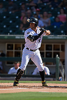 Yoan Moncada (10) of the Charlotte Knights at bat against the Gwinnett Braves at BB&T BallPark on July 16, 2017 in Charlotte, North Carolina.  The Knights defeated the Braves 5-4.  (Brian Westerholt/Four Seam Images)