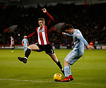 John Lundstram of Sheffield Utd attempts to block Bryan Oviedo of Sunderland during the Championship match at Bramall Lane Stadium, Sheffield. Picture date 26th December 2017. Picture credit should read: Simon Bellis/Sportimage