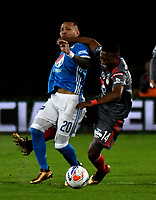 BOGOTA - COLOMBIA - 19 – 01 - 2018: Juan Guillermo Dominguez (Izq.) jugador de Millonarios disputa el balón con Ivan Velez (Der.) jugador de America de Cali, durante partido entre Millonarios y America de Cali, por el Torneo Fox Sports 2018, jugado en el estadio Nemesio Camacho El Campin de la ciudad de Bogota. / Juan Guillermo Dominguez (L) player of Millonarios vies for the ball with Ivan Velez (R) player of America de Cali, during a match between Millonarios and America de Cali, for the Fox Sports Tournament 2018, played at the Nemesio Camacho El Campin stadium in the city of Bogota.Photo: VizzorImage / Luis Ramirez / Staff.