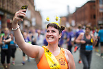 © Joel Goodman - 07973 332324 . 28/05/2017 . Manchester , UK . A woman wearing bee deely boppers takes a selfie at the finish line . The Great Manchester Run 2017 . Security is still heightened in Manchester following a murderous bomb attack at an Ariana Grande gig at Manchester Arena on Monday 22nd May . Photo credit : Joel Goodman
