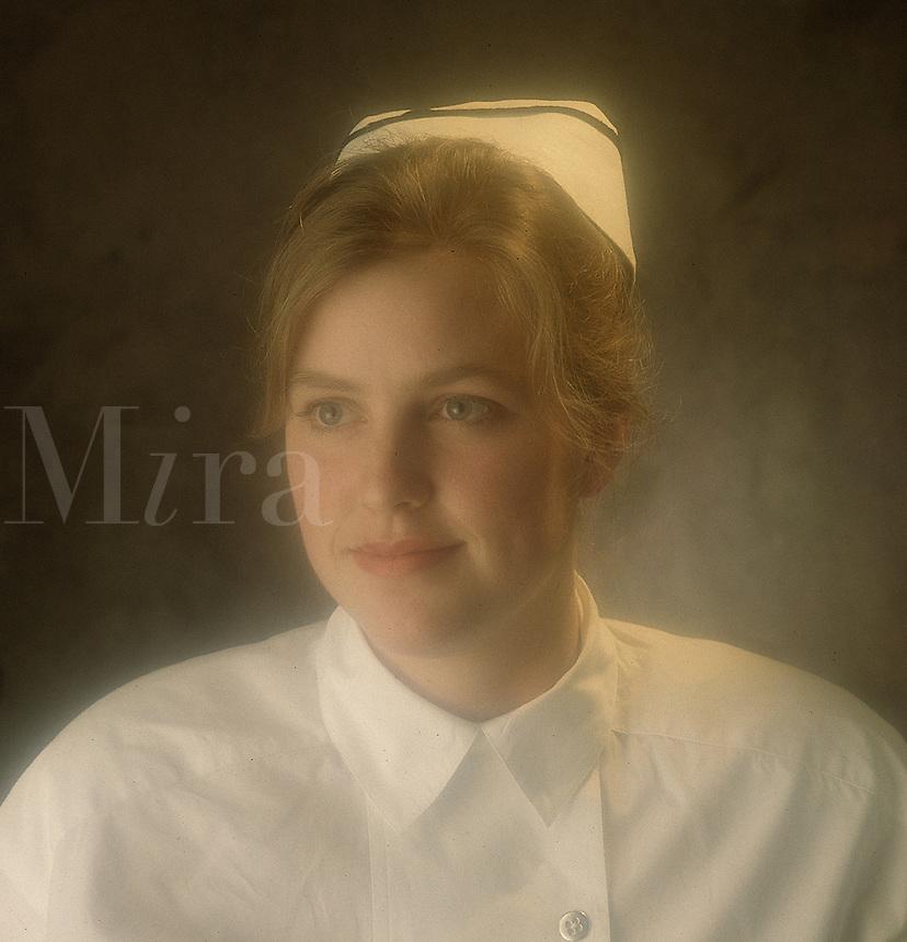 Model poses in old-fashioned nursing uniform.
