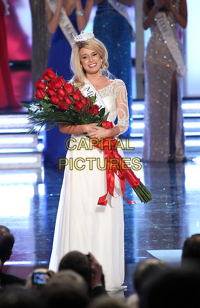 TERESA SCANLAN - Miss America 2011.Miss Nebraska Teresa Scanlan is named the Miss America 2011 at The Theater for the Performing Arts at Planet Hollywood Resort Hotel and Casino, Las Vegas, Nevada, USA, .15th January 2011..full length white dress sash winner crowned crown on stage one shoulder long maxi red roses flowers .CAP/ADM/MJT.© MJT/AdMedia/Capital Pictures.