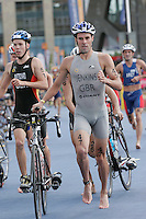30 JUL 2006 - SALFORD, UK - Marc Jenkins leaves T1 at the Salford ITU World Cup triathlon round. (PHOTO (C) NIGEL FARROW)