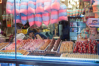 A candied apples stand is pictured on Coney Island in New York city borough of Brooklyn, Sunday July 31, 2011. Candy apples, also known as toffee apples outside of North America, are whole apples covered in a hard sugar candy coating.