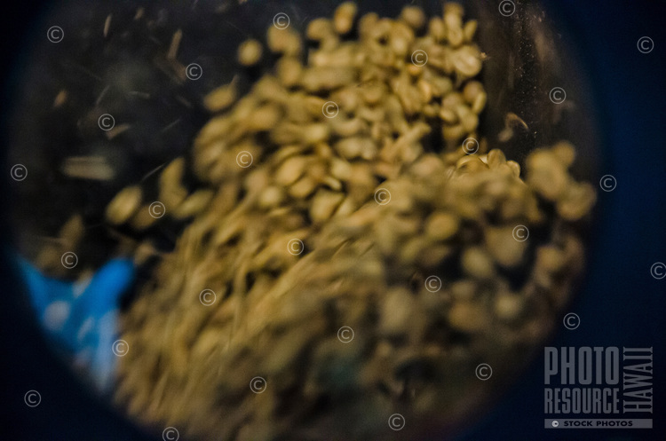 A close-up of roasting coffee beans in a roaster at Kaleo's Koffee, Pa'auilo, Hamakua Coast, Big Island.