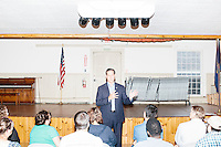 Former Pennsylvania senator and Republican presidential candidate Rick Santorum speaks at a town hall campaign event at Weare Town Hall in Weare, New Hampshire.
