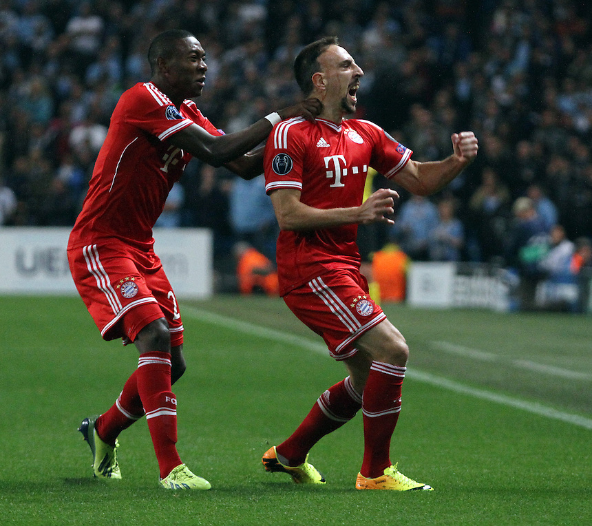 Bayern Munich's Franck Ribery (right) celebrates scoring the opening goal with teammate David Alaba<br /> <br /> Photo by Rich Linley/CameraSport<br /> <br /> Football - UEFA Champions League Group D - Manchester City v Bayern Munich - Wednesday 2nd October 2013 -  Etihad Stadium - Manchester<br /> <br /> &copy; CameraSport - 43 Linden Ave. Countesthorpe. Leicester. England. LE8 5PG - Tel: +44 (0) 116 277 4147 - admin@camerasport.com - www.camerasport.com