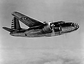 "When the United States entered World War 2,  the A-20 attack bomber had already been proven in combat by British and French forces. On July 4, 1942, six A-20s flown by American crews of the 15th Bombardment Squadron accompanied six flown by British crews on a low-altitude mission against four Dutch airfields, the first United States daylight bombing raid in Europe.  The versatile A-20 was used in the Pacific, Middle East, North African, Russian, and European theaters. Some A-20s equipped with radar equipment and additional nose guns were redesignated as P-70s and were used as night fighters until replaced in 1944 by the P-61 ""Black Widow"" with its increased high altitude performance.  A-20 production halted in September 1944 with more than 7,000 built for the United States and its allies. .Credit: U.S. Air Force via CNP"