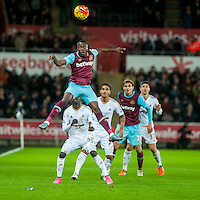 Enner Valencia of West Ham United jumps high for the ball during the Barclays Premier League match between Swansea City and West Ham United played at the Liberty Stadium, Swansea  on December 20th 2015