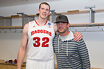 Wisconsin Badgers Evan Anderson with Green Bay Packers quarterback Aaron Rodgers after  a regional semifinal NCAA college basketball tournament game against the Baylor Bears Thursday, March 27, 2014 in Anaheim, California. The Badgers won 69-52. (Photo by David Stluka)