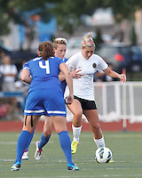 Portland Thorns FC midfielder Allie Long (10) attempts to control the ball as Boston Breakers midfielder Joanna Lohman (11) pressures. In a National Women's Soccer League (NWSL) match, Boston Breakers (blue) defeated Portland Thorns FC (white/black), 2-1, at Dilboy Stadium on August 7, 2013.
