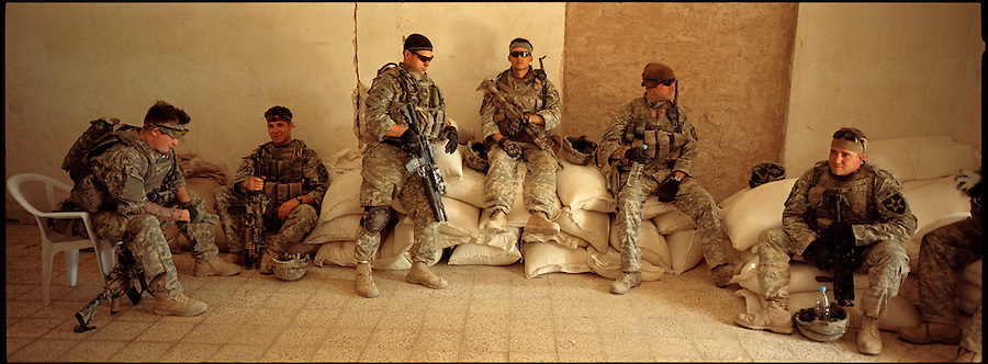 Soldiers from 5-20 Infantry 3HBCT 2nd Infantry Division take a break from the Iraqi summer sun during a patrol  in the Diyala provincial capital, Baqubah, on Monday May 28, 2007.