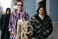 Mia Moretti and Leandra Medine attend Day 4 of New York Fashion Week on Feb 15, 2015 (Photo by Hunter Abrams/Guest of a Guest)
