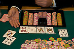 A poker dealer's hand with cards and chips In Las Vegas Nevada, Caesars Palace and Casino, gaming, gambling, poker, model released, NV, Las Vegas, Photo nv218-16919..Copyright: Lee Foster, www.fostertravel.com, 510-549-2202,lee@fostertravel.com