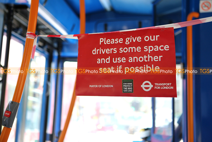 A sign on the 314 bus from Eltham to New Addington asks passengers to sit down a safe distance from the driver.  The Kent COVID-19 pandemic continues to have a severe impact throughout Kent and South East London on 21st May 2020