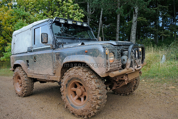 Muddy Land Rover Defender 90 on a forest track in the Weserbergland. Seen at an off-road event of the German Land Rover Club held at the Freizeitpark Mammut in Stadtoldendorf, Germany, October 3.-5. 2008. --- No releases available. Automotive trademarks are the property of the trademark holder, authorization may be needed for some uses.