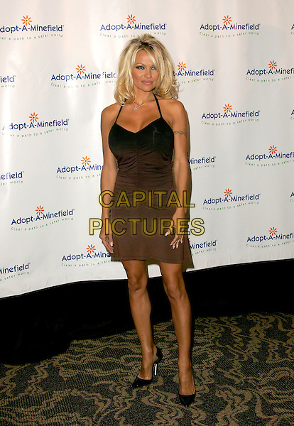PAMELA ANDERSON.The 4th Annual Benefit Gala for Adopt-A-Minefield held at The Century Plaza Hotel in Century City, California.October 15th, 2004.full length, brown, black halterneck dress, tattoo.www.capitalpictures.com.sales@capitalpictures.com.©Debbie Van Story/Capital Pictures