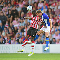 Lincoln City's John Akinde vies for possession with Sheffield Wednesday's Sam Hutchinson<br /> <br /> Photographer Chris Vaughan/CameraSport<br /> <br /> Football Pre-Season Friendly - Lincoln City v Sheffield Wednesday - Friday 13th July 2018 - Sincil Bank - Lincoln<br /> <br /> World Copyright &copy; 2018 CameraSport. All rights reserved. 43 Linden Ave. Countesthorpe. Leicester. England. LE8 5PG - Tel: +44 (0) 116 277 4147 - admin@camerasport.com - www.camerasport.com