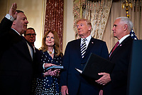 Mike Pompeo, United States secretary of state, is sworn in by Vice President Mike Pence, as U.S. President J. Donald Trump, Susan Pompeo, and Nick Pompeo look on, at the State Department, in Washington, D.C., U.S., on Wednesday, May 2, 2018. <br /> Credit: Al Drago / Pool via CNP /MediaPunch