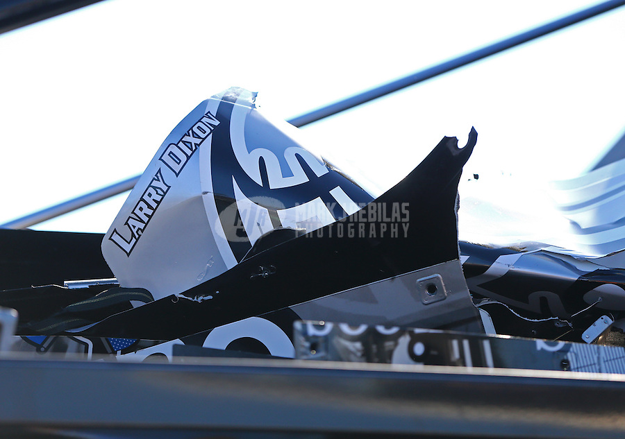 Mar 15, 2015; Gainesville, FL, USA; Detailed view of destroyed parts from the dragster of NHRA top fuel driver Larry Dixon after a crash during qualifying on Saturday for the Gatornationals at Auto Plus Raceway at Gainesville. Mandatory Credit: Mark J. Rebilas-