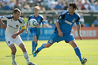 San Jose Earthquakes defender Bobby Burling (2) kicks the ball against Los Angeles Galaxy defender Gregg Berhalter (3). The San Jose Earthquakes tied the Los Angeles Galaxy 0-0 at Buck Shaw Stadium in Santa Clara, California on June 25th, 2011.