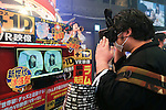 A visitor experiences 3D visual effects during the first day of the Japan Adult Expo 2015 on November 17, 2015, Tokyo, Japan. 69 film production companies, novelty goods makers and over a hundred AV actresses will attend the second annual two day expo in Toyosu Pit from November 17 to 18. Organizers aim to give fans the opportunity to meet their idols. (Photo by Rodrigo Reyes Marin/AFLO)