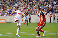 Luke Rodgers (9) of the New York Red Bulls shoots and scores during a Major League Soccer (MLS) match against Toronto FC at Red Bull Arena in Harrison, NJ, on July 06, 2011.