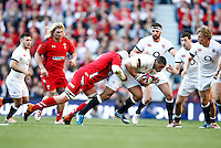 Photo: Richard Lane/Richard Lane Photography. England v Wales. RBS Six Nations. 09/03/2014. England's Luther Burrell attacks.