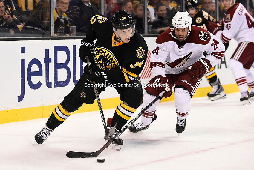 February 28, 2015 - Boston, Massachusetts, U.S. - Boston Bruins center Carl Soderberg (34) and Arizona Coyotes center Kyle Chipchura (24) work for the puck during the NHL match between the Arizona Coyotes and the Boston Bruins held at TD Garden in Boston Massachusetts. The Bruins defeated the Coyotes 4-1 in regulation time. Eric Canha/CSM