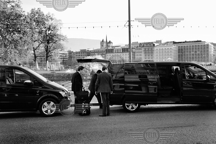 Foreign visitors with their hired transport, with tinted windows, parked opposite one of the city's five star hotels, with the city centre across the lake behind. Geneva claims to have invented private banking, and 80 banks - many of them foreign, handle an estimated 40% of foreign assets, in Switzerland. The city of Calvin is also home to hundreds of finance companies and independent asset managers feeding into this system. It has also become a major centre for trading companies dealing in primary materials ranging from oil to wheat.