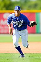 Burlington Royals third baseman Patrick Leonard #30 charges a ground ball during practice at Burlington Athletic Park on June 15, 2012 in Burlington, North Carolina.  (Brian Westerholt/Four Seam Images)