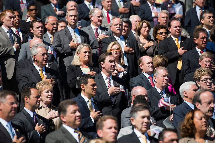 UNITED STATES - SEPTEMBER 11: Members of Congress and Senate hold their hands over their hearts for the national anthem during the 9/11 Congressional Remembrance Ceremony on the East Front of the Capitol on Tuesday, Sept. 11, 2012. (Photo By Bill Clark/CQ Roll Call)