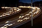 Een stroom verkeer bestaande uit auto's, vrachtwagens en trucks trek sporen over het asfalt op de snelweg A27 kruising A12 bij Utrecht.COPYRIGHT TON BORSBOOM