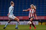 Olivia Fergusson of Sheffield United passes the ball past Nadine Hanson of Aston Villa during the The FA Women's Championship match at the Proact Stadium, Chesterfield. Picture date: 12th January 2020. Picture credit should read: James Wilson/Sportimage
