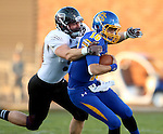 BROOKINGS, SD - OCTOBER 11:  Zach Lujan #16 from South Dakota State is brought down by Deion Holliman #5 from Missouri State in the first half of their game Saturday evening at Coughlin Alumni Stadium in Brookings. (Photo/Dave Eggen/Inertia)