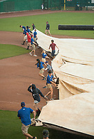 NWA Democrat-Gazette/BEN GOFF @NWABENGOFF<br /> Grounds crews spread the infield tarps after the 8th inning in the Northwest Arkansas vs Arkansas game Wednesday, May 16, 2018, at Arvest Ballpark in Springdale. The game was later called for weather.