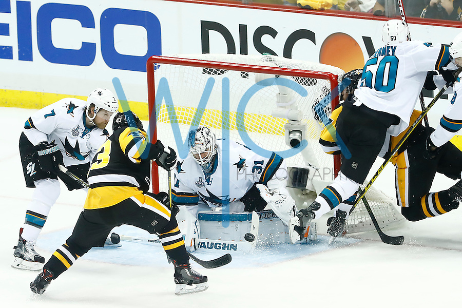Martin Jones #31 of the San Jose Sharks makes a save in front of Conor Sheary #43 of the Pittsburgh Penguins in the third period during game five of the Stanley Cup Final at Consol Energy Center in Pittsburgh, Pennsylvania on June 9, 2016. (Photo by Jared Wickerham / DKPS)