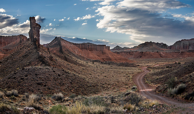 Light from a setting sun brightens Cathedral Valley at Capitol Reef National Park, Utah