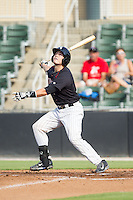 Brett Austin (10) of the Kannapolis Intimidators follows through on his swing against the Asheville Tourists at CMC-NorthEast Stadium on July 13, 2014 in Kannapolis, North Carolina.  The Tourists defeated the Intimidators 8-2.  (Brian Westerholt/Four Seam Images)