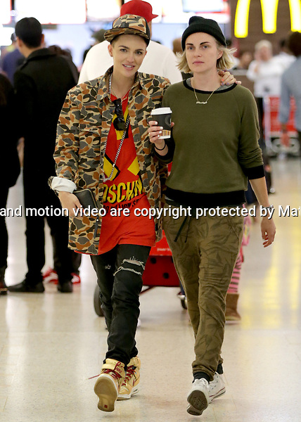 11 APRIL 2014 SYDNEY AUSTRALIA<br /> <br /> EXCLUSIVE <br /> <br /> Ruby Rose pictured at Sydney International Airport waiting for and greeting her fianc&eacute; Phoebe Dahl as she arrives in Sydney for the first time. Ruby was ecstatic as she greeted her fianc&eacute; and the pair were smitten with each other as they waiting for a coffee and walked to the limousine.<br /> <br /> <br /> *No internet without clearance*.MUST CALL PRIOR TO USE +61 2 9211-1088. Matrix Media Group.Note: All editorial images subject to the following: For editorial use only. Additional clearance required for commercial, wireless, internet or promotional use.Images may not be altered or modified. Matrix Media Group makes no representations or warranties regarding names, trademarks or logos appearing in the images.
