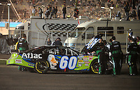Apr 17, 2009; Avondale, AZ, USA; NASCAR Nationwide Series driver Carl Edwards sits behind the wall after suffering an engine problem during the Bashas Supermarkets 200 at Phoenix International Raceway. Mandatory Credit: Mark J. Rebilas-