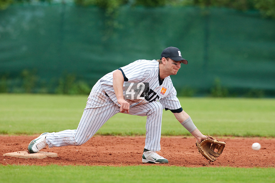 03 June 2010: Shortstop Aaron Hornostaj of Rouen eyes the ball during the 2010 Baseball European Cup match won  8-4 by C.B. Sant Boi over the Rouen Huskies, at the Kravi Hora ballpark, in Brno, Czech Republic.