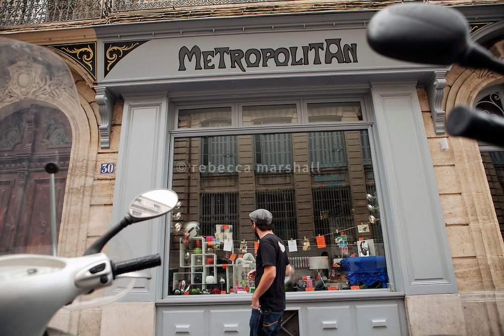 Window display at Metropolitan, an art gallery and home-décor shop in l'Ecusson, Montpellier, France, 14 July 2012