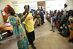 ARUA , UGANDA, JULY 7, 2006 : The PHA group 'PMTCT' (Prevention Mother To Child Transmition) perform in the waiting room of the HIV clinic run by MSF in Arua Hospital, in Arua, Uganda on July 7, 2006. The ARV treatment program started July 2002 at the HIV clinic run by MSF in Arua hospital. (Photo by Jean-Marc Giboux)